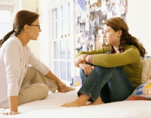 parent having meaningful conversation with child
