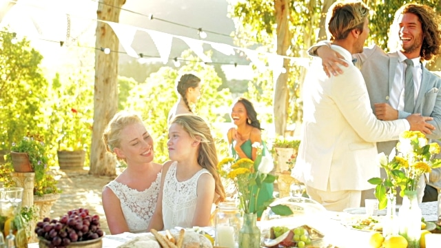 family talking at wedding