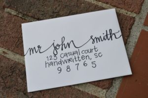 handwritten addresses on DIY wedding invitations