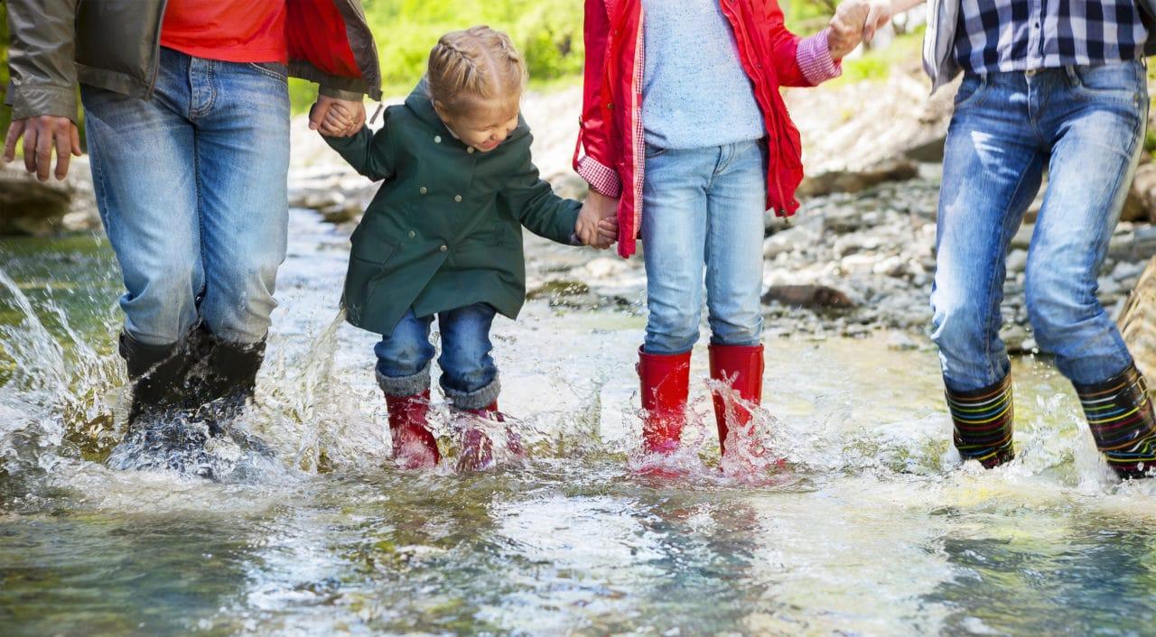 family having fun in the rain