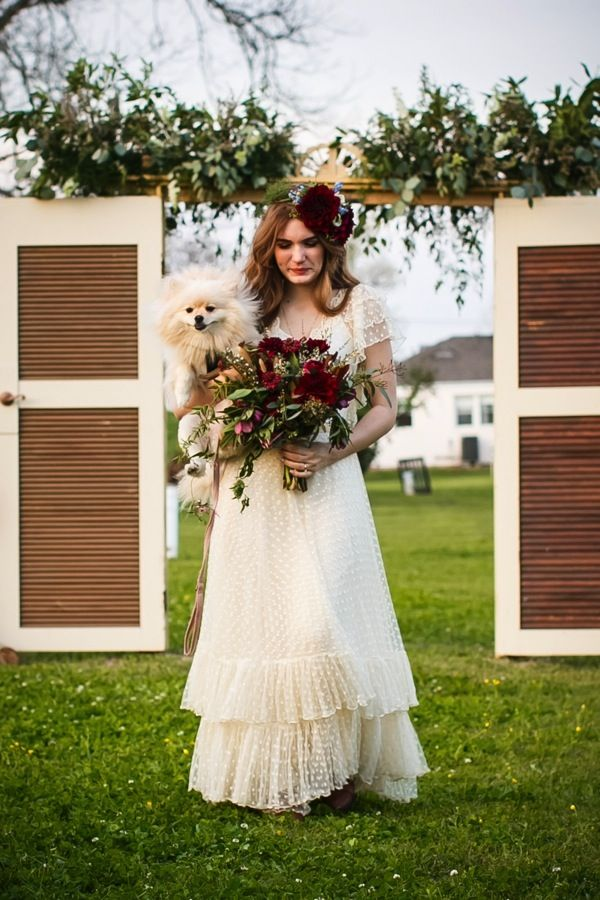 Bride carrying dog instead of bouquet