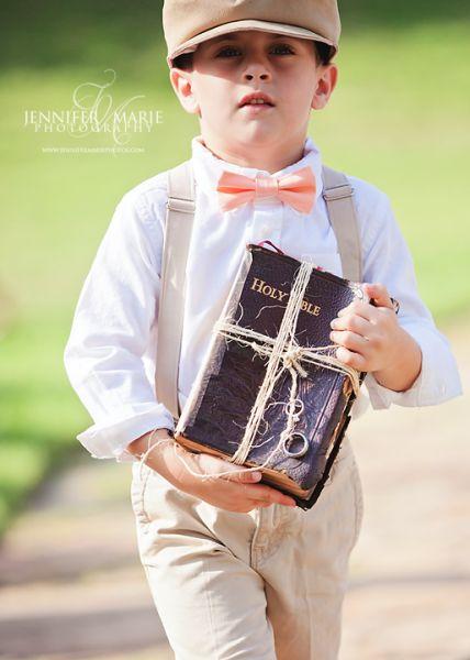 Ring bearer carrying Bible