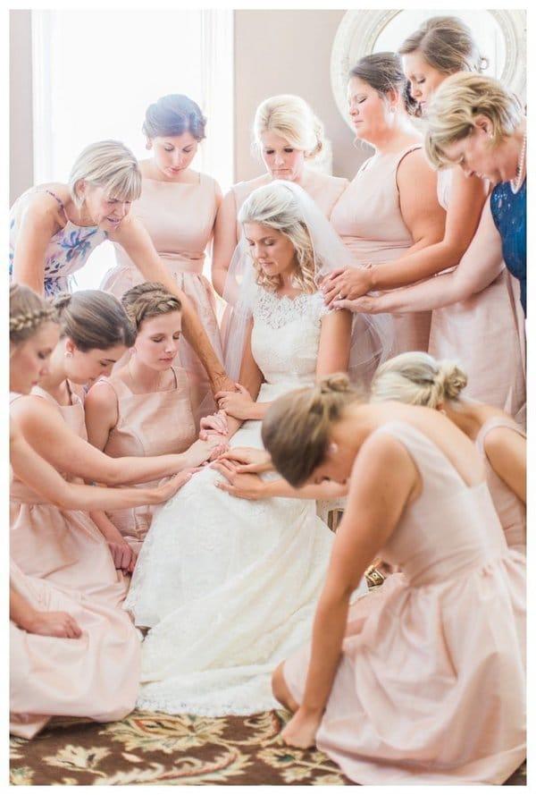 Bridesmaids praying