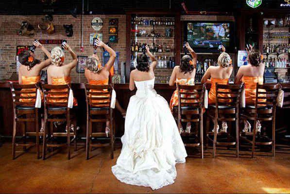 Bridesmaids drinking at bar