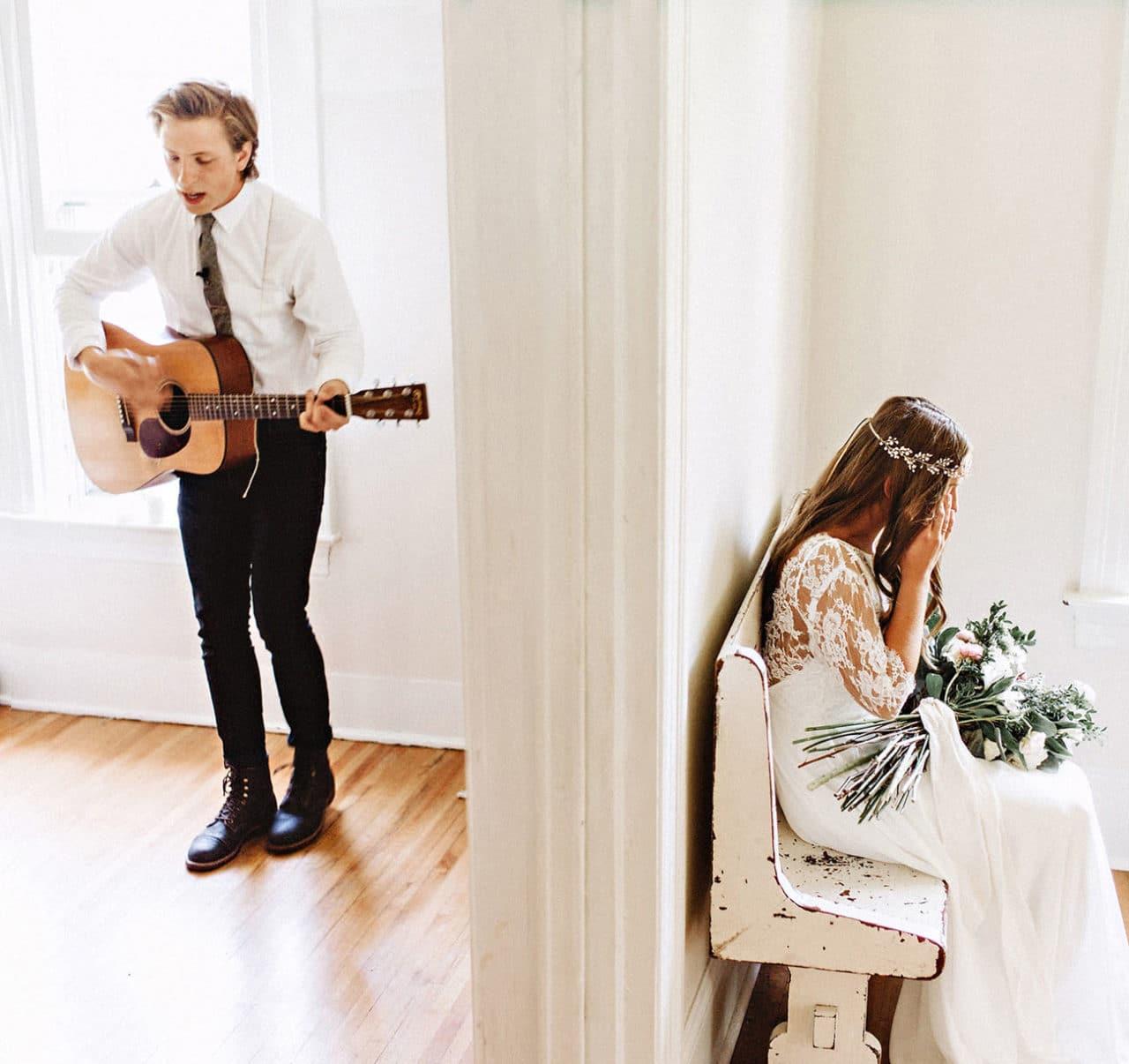 groom singing to bride before wedding