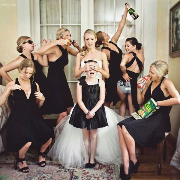 Bridesmaids drinking and laughing with flower girl