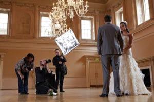 Two Wedding Photographers Photographing Newlyweds