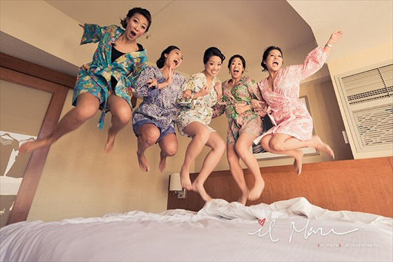 Bridesmaids Jumping on Bed