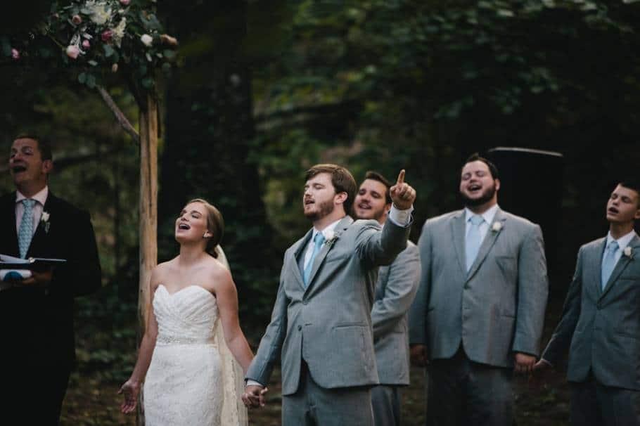 Newlyweds worshiping at wedding ceremony
