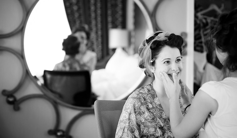 bride doing hair and makeup