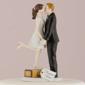 travel-themed wedding cake topper