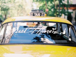 travel themed wedding getaway taxi