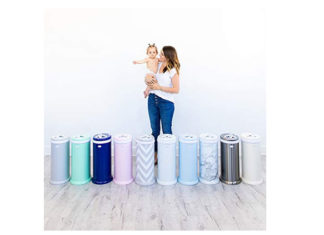 Woman is carrying her baby while in front of them is a diaper pail