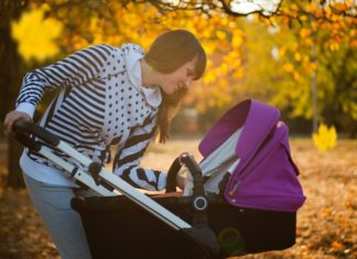 mother checking her baby who is inside the best lightweight stroller